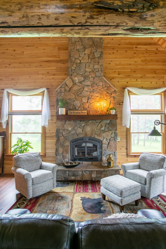 Floor to Ceiling Stone Covered Fireplace with Raised Hearth