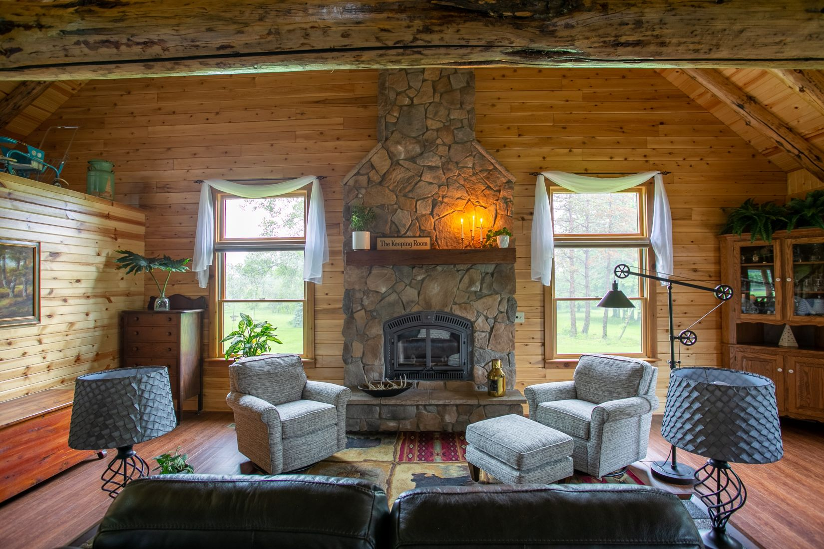 The Keeping Room with a stone covered fireplace