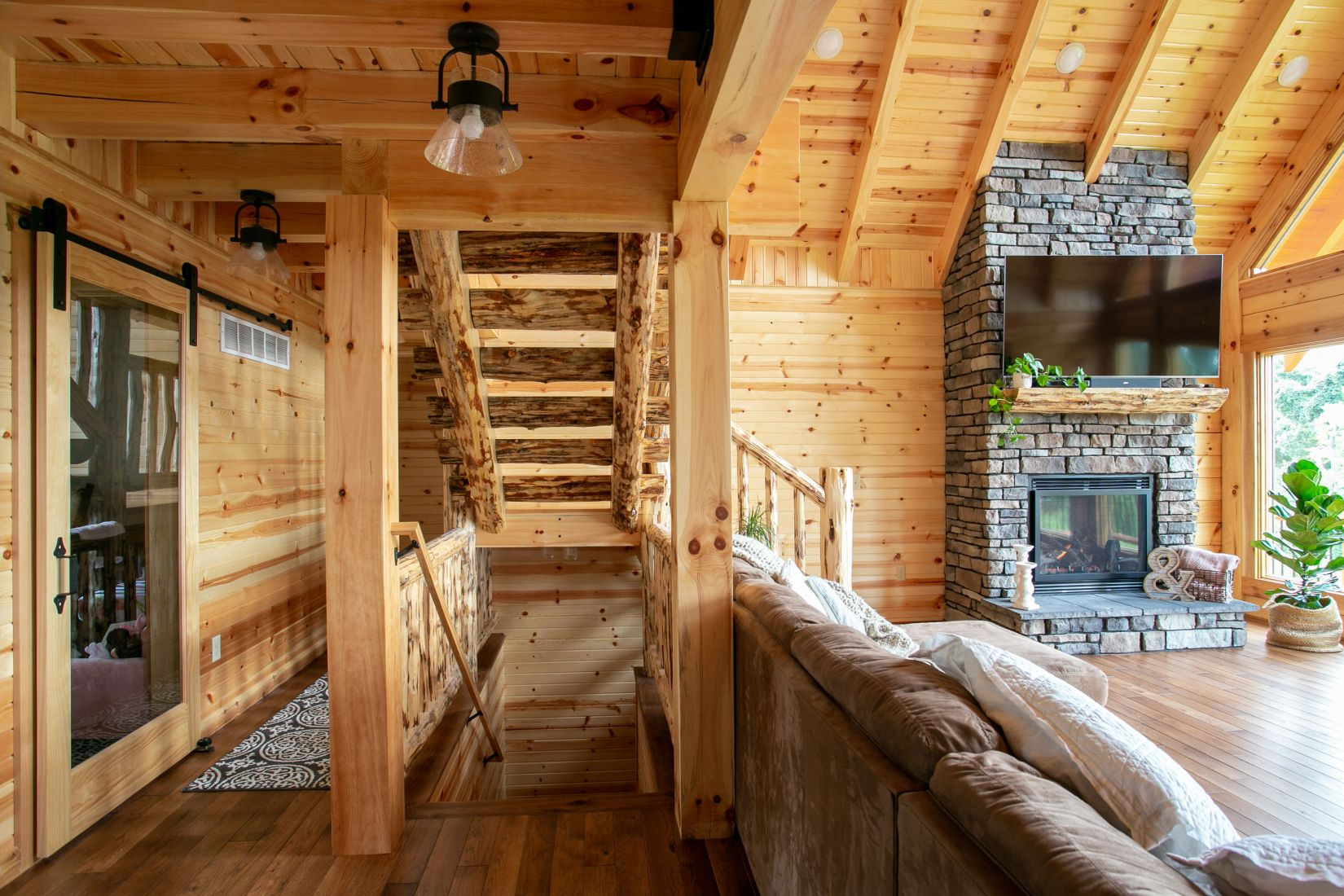 Rustic Log Stairway to Second Floor - Square Log Roof System