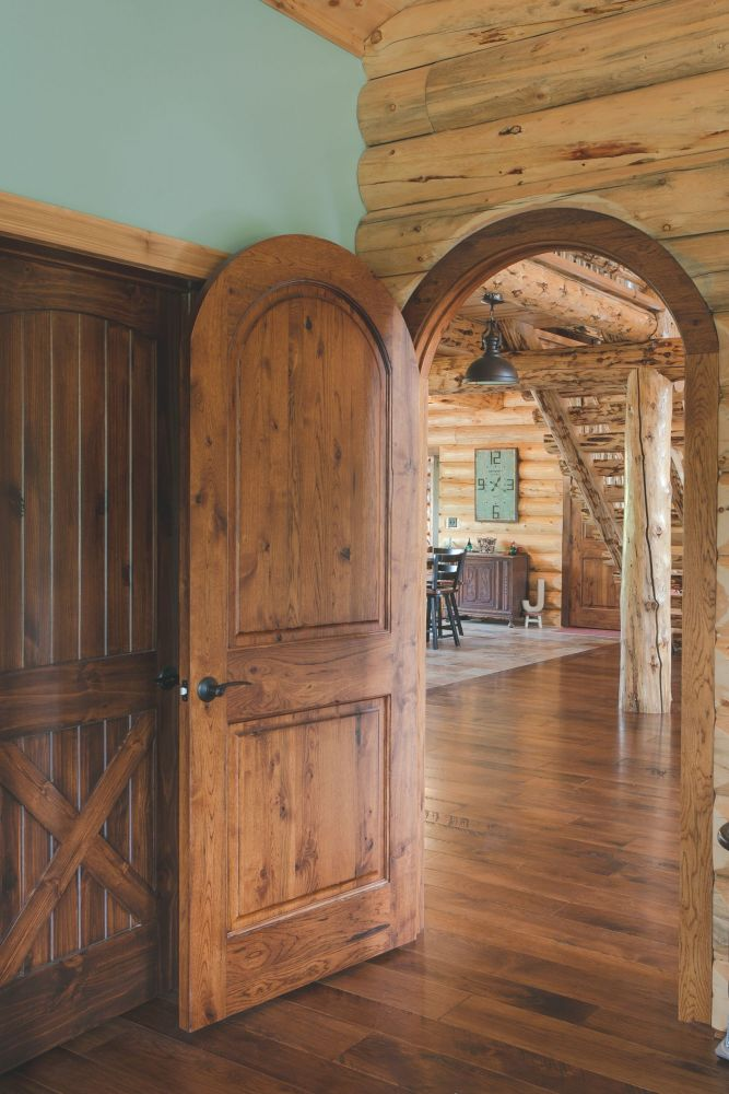 Two Panel Arch Top Knotty Pine Door - Stained