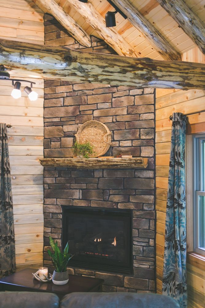 Gas Fireplace Covered with Stone Veneer and Topped with a Log Mantle