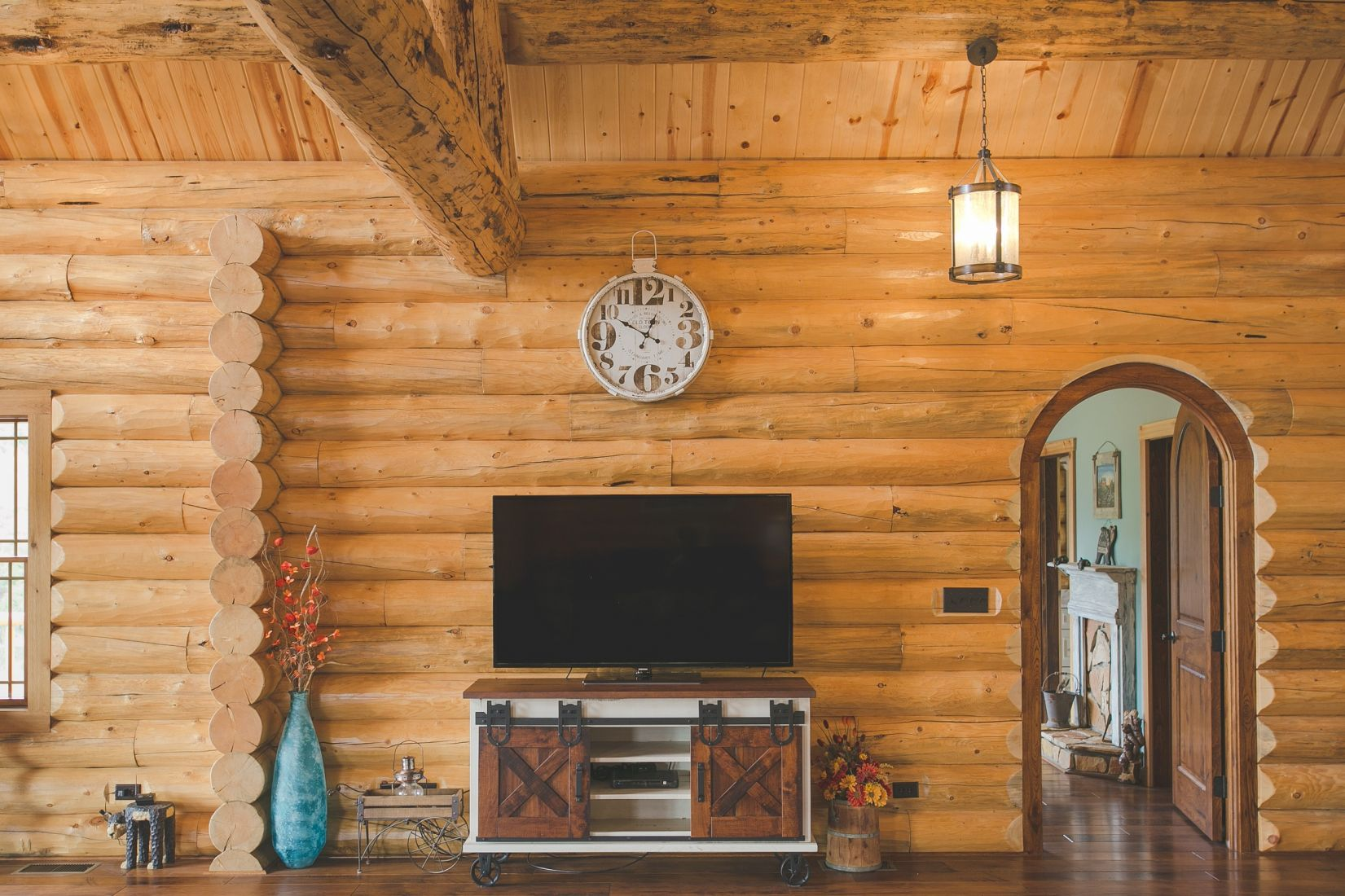 Interior Log Siding on Walls with Arched Bedroom Door