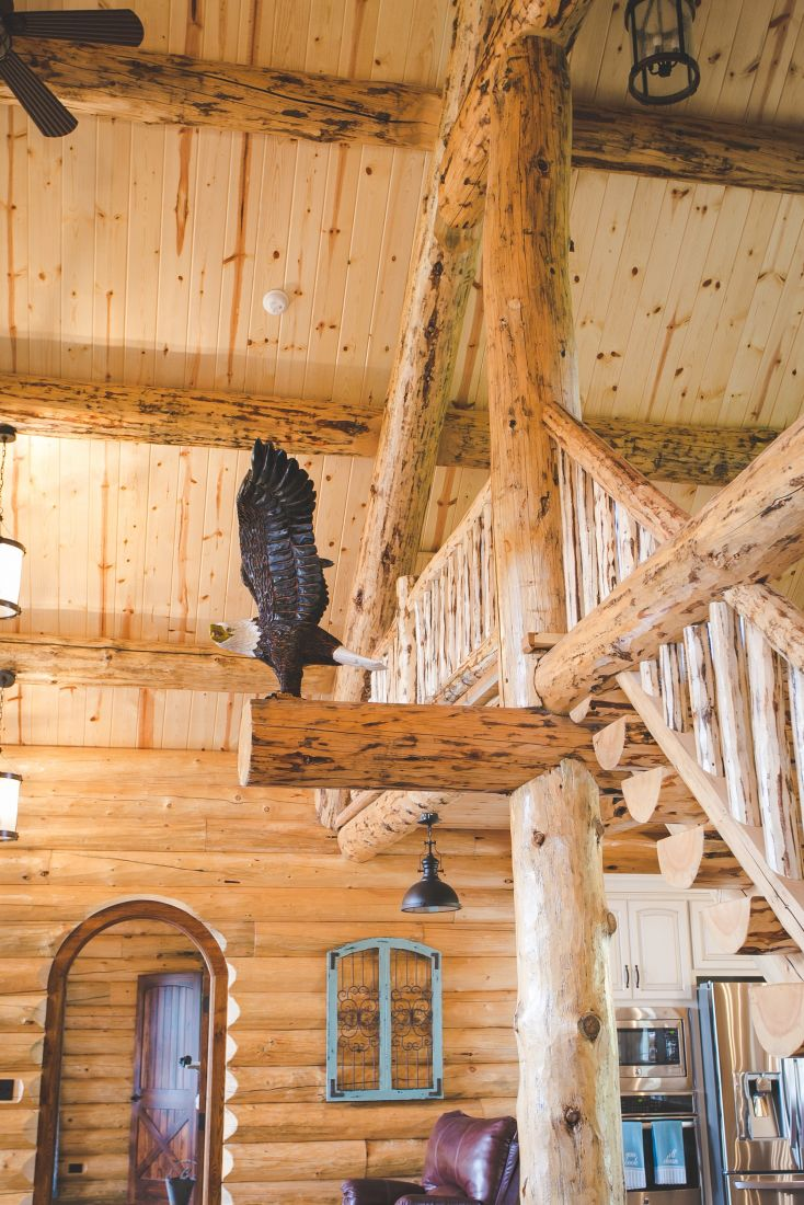 Hand Carved Eagle Accent Perched on this Log Support Beam