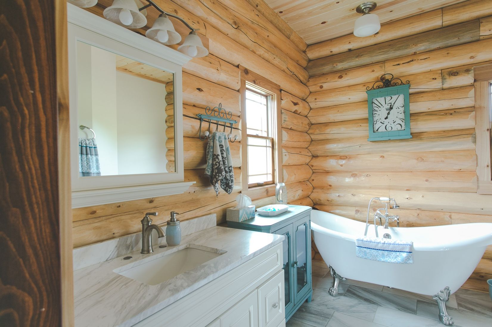 Master Bathroom White Vanity with White Claw Foot Tub