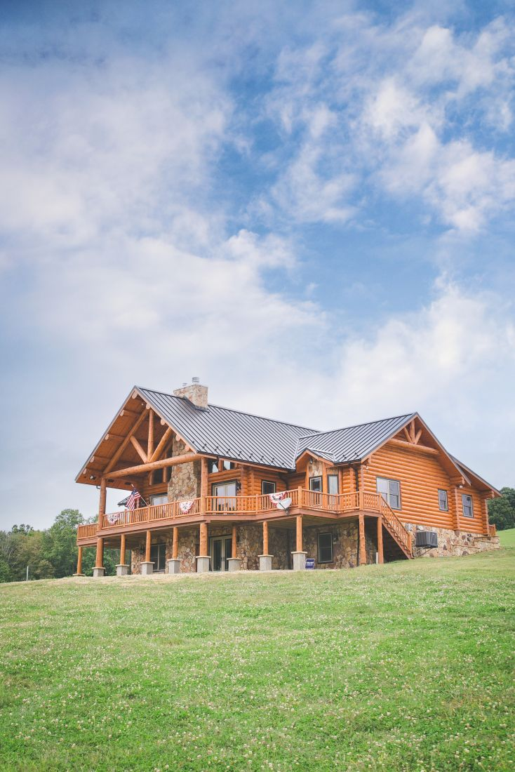 Log Home with Gabled Porch Roof