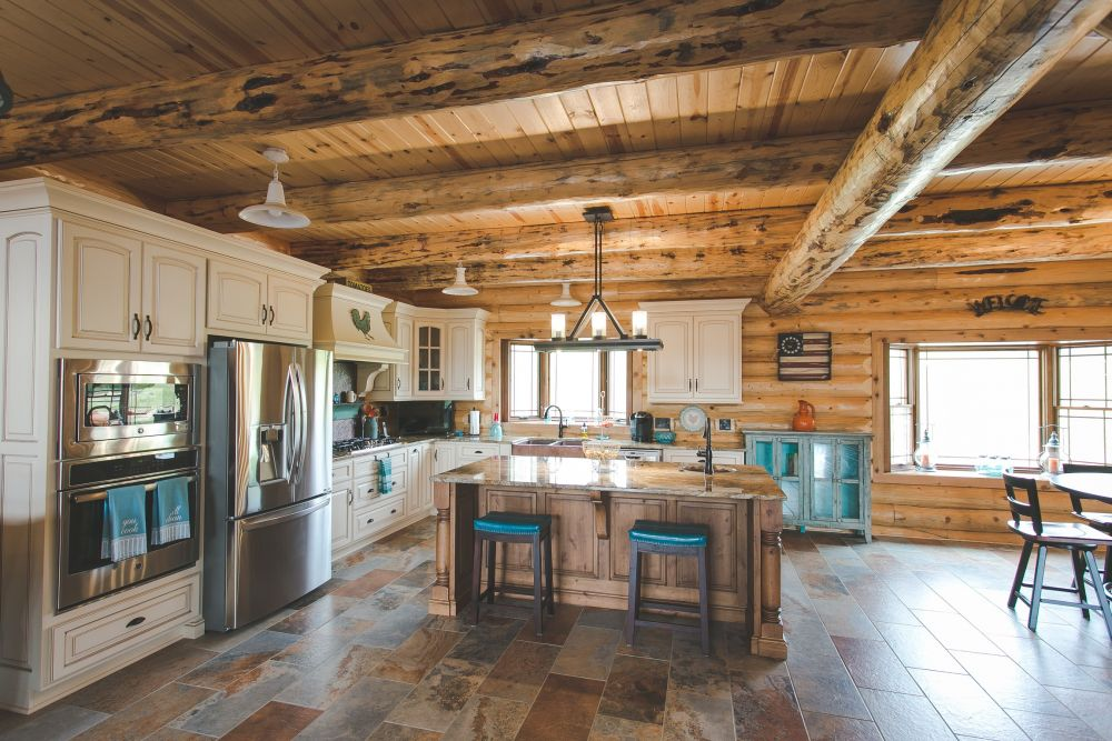 Log Home Custom Kitchen with White Painted Cabinets and Stained Island