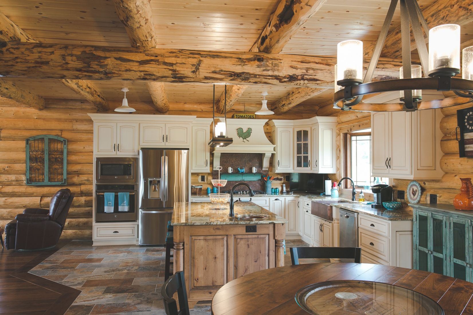 White Kitchen Cabinets in a Log home with Stainless Steel Appliances