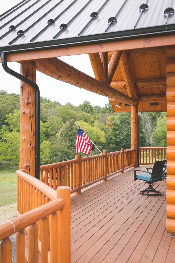 Large Porch Covered with a Log Roof System