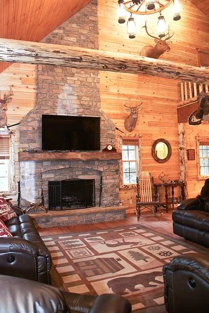 Rustic Log Home with Stone Covered Fire Place